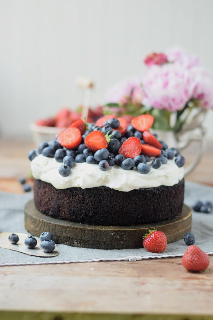 Chocolate Blueberry Brownie With Cream And Berries